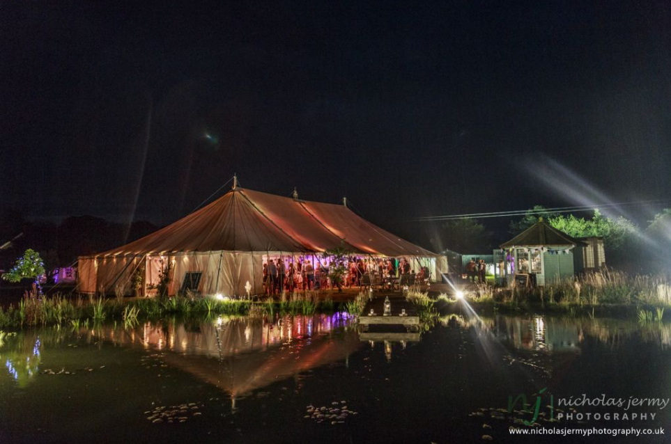 By day and by night, with our event planning and mobile bar service, we make sure everything looks beautiful for your wedding reception or party. Here's the night view of Nina and Gavin Tills Wedding (Photo by Nicholas Jermy Photography)